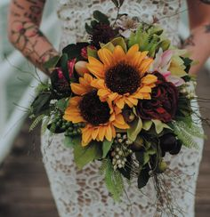 exactly what I envision for my bridal bouquet - moody, sunflowers as main flower, lots of greenery and fill in our wedding colours. - wedding sunflowers Lovely exactly what I envision for my bridal bouquet - moody, sunflowers as main flower. Bridal Bouquet Fall, Fall Bouquets, Fall Wedding Bouquets, Bridal Flowers, Bridal Bouquets, Wedding Bouquets With Sunflowers, Fall Flowers, Wedding Dresses, Sunflower Centerpieces