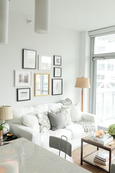 White Couch with Gray Accents and Simple Coffee Table. From @Danielle Lampert Moss.
