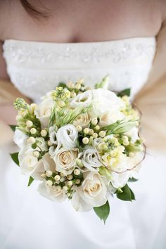 White and Cream bouquet. I especially love the rose hips or white berries as a unique texture.