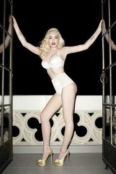 Magazine: Love #7, Spring Summer 2012  Editorial: 'Smoking'  Style: Sally Lyndley  Model: Lindsay Lohan  Photography: Terry Richardson