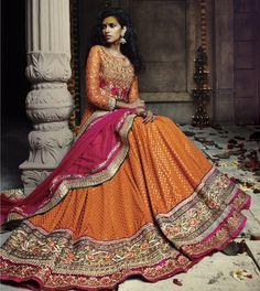 162466: Orange color family Mehendi & Sangeet Lehenga .