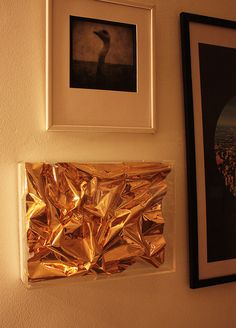 gold wrapping paper in acrylic framw