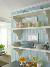 long plank shelves with decorative brackets