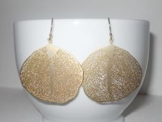 Detailed Leaf Dangle Earrings in Gold - Retro Gold Leaf Filigree Pendant Delicate Dangle Earrings. $20.00, via Etsy.