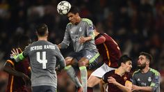 Raphaël Varane (C) of Real Madrid in action during their UEFA Champions League round of 16 first leg against Roma
