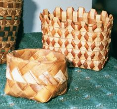 """Two birch bark baskets, a world apart. Right: """"Curly"""" basket made with birch bark from Michigan at a class by Cass Schorsch - NCBA.  Left: Square to round basket made with birch bark from Nizhny Novgorod, Russia. Vladimir Yarish taught us at High Country Basketry Guild in Annandale, Virginia (1997) (""""no good, take out"""" :-) )"""