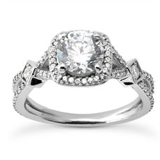 Round diamond with cushion shaped halo and geometric split shank. Smashing!
