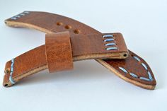 Hard leather orange - light brown blue stitching watch strap handmade 18mm 100% handmade strap watch is made of premium quality hard leather. Stitched entirely by hand very high quality waxed thread. Size 18mm per 18mm. on buckle. About 4mm thiсk. Long part 120mm, short part 70mm. Not used not natural dyes or paints. Made in one piece. Will be perfect and reliable decoration for your wrist watch. I hope you enjoy. !!!Make sure that the distance between the watch case and springbars is…