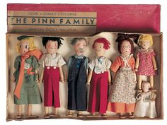 "Promises of Paris: 164 Wooden Dolls 'The Pinn Family' in Box Seven dolls, 5""-12"" (13 - 30 cm). Each is all wooden with bedpost-heads, simplistically painted facial features, yarn hair in various colors, block torso, clothespin arms and legs. CONDITION: Generally excellent. MARKS: Patent Pending c.1935 E.T.M. St. Paul Minn. COMMENTS: The successors to the Schoenhut firm produced this imaginative set of dolls from bedposts and clothespins, circa 1935."