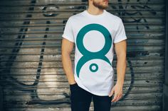 Man wearing white T-Shirt Mockup | MockupWorld