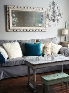 Comfy--IKEA couch with an updated slipcover.  Love the variety of texture in the room.