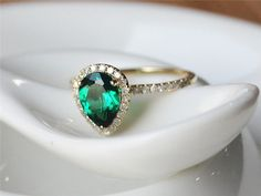 Metal Type of this ring is in Solid 14k Yellow White Gold Main Stones is Pear Cut VVS Treated Emerald,about 1.6ctw Natural Diamonds about
