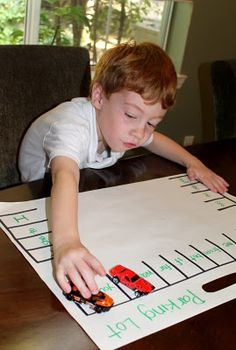 "Parking Lot Game--Call out a word (or letter), and have your child ""park"" the car in that place. Great for sight words."