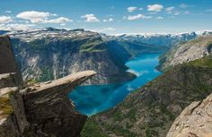 Trolltunga is one of the most spectactular scenic cliffs in Norway. Trolltunga  is situated about 1100 meters above sea level, hovering 700 metres above lake Ringedalsvatnet in Skjeggedal. The view is breathtaking. Trolltunga is so popular among tourists that sometimes it's a 20 minute wait just to take pictures. http://www.opplevodda.com/