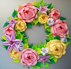 This rose wreath is entirely made out of paper. The flowers are very close to life size.