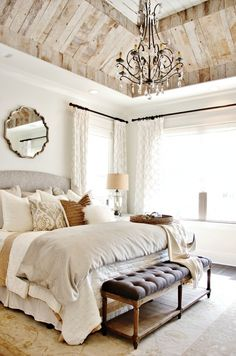 amazing rustic wood vaulted ceiling in a gorgeous neutral bedroom