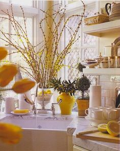 Welcome Spring!  Love the corner sink and pops of yellow.