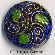 Czech glass button dark blue with green leafs and gold accent swirl - size 16, 36 mm FCB 1043 by buttonsandshanks on Etsy