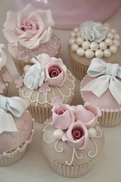 These cupcakes look elegant.  Also the pastel colors and the white piping provide that vintage look.  These will be perfect for a vintage wedding or a pastel wedding.  They will not work for all weddings.