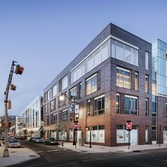 view of the charter schools and the residential building along Halsey Street looking North</em>Copyright Scott Frances. Halsey Street, Building Front, Williams Street, Richard Meier, Washington Street, Brick Facade, Sense Of Place, Sustainable Design, Park City