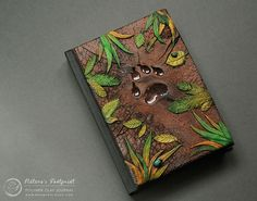 Fantasy Ebook Covers By Latvian Artist Come Alive With Dragons And Lizards 'Polymer clay' seems like what cyborg golems are comprised of, however it's really the fabric Aniko Kolesnikova makes use of to make implausible e-boo. Book Cover Design, Book Design, Polymer Journal, Fantasy Magic, Fantasy Books, Sketchbook Cover, Sketchbook Ideas, Journal Covers, Book Covers