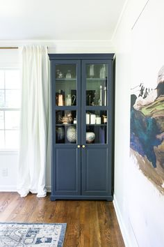 Hale Navy IKEA Liatorp Cabinet Makeover for a Home Office. Tips for painting laminate Ikea furniture and the best navy blue paint color perfect for adding pop to a neutral room.