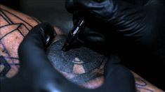 An Incredible Slow Motion Video of a Tattoo Artist Working