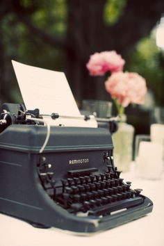 "Guests will sign the ""guest book"" on a vintage typewriter.  The tossing bouquet will sit on a vase next to it."