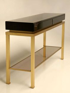 Pair Of Consoles By Guy Lefevre For Maison Jansen | From a unique collection of antique and modern console tables at http://www.1stdibs.com/furniture/tables/console-tables/
