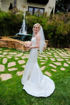 Beautiful bride in front of fountain at Estancia La Jolla Hotel | Jim Kennedy Photographers