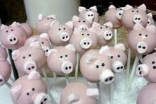Pig cake pops using pink mini marshmallows for ears and snout. Bakerella pop star