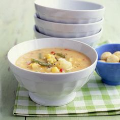 Corn, bell peppers, and green beans give this hearty soup its fresh, summery flavor; make a batch now, then freeze for up to six months. If you plan to freeze the soup, cook the green beans for a few minutes less than called for in step 4; this will help them retain their crunch after the soup is reheated.