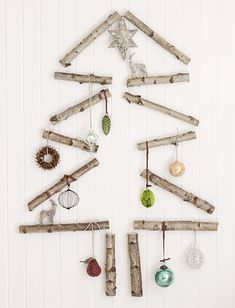 40 DIY Alternative Christmas Trees Adding Fun Wall Decorations to Green Holiday Decor Christmas Stairs Decorations, Unique Christmas Trees, Alternative Christmas Tree, Wooden Christmas Trees, Handmade Christmas Decorations, Christmas Holidays, Christmas Crafts, Holiday Decor, Wall Decorations