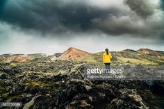 Stock Photo : Rear View Of Woman Standing On Rock