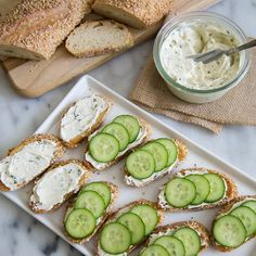 Garlic and chive cream cheese spread with toasted baguette and sliced cucumbers