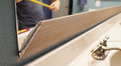 This is the best DIY project I've ever tried. This DIY Bathroom Mirror Frame will easily and affordably transform your bathroom in an afternoon! Read more..