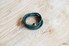donkergroen leren armband met koperkleurige sluiting