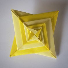April 3rd 2015 Origami spiral star I made today. #origami #spiral #star #yellow #paper #folding #diy #craft #93