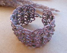 Passion Purple never looked so good... by Laura on Etsy.  This treasury features one of my pair of earrings.