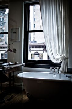 um...yes, yes, yes, yes, yes. 1) clawfoot tub with handheld shower 2) dramatic shower curtain 3) in the middle of a big bedroom. yes. weirdo, but to have a tub NOT in an ugly small bathroom is so nice.  The New Victorian Ruralist: The Nomad...
