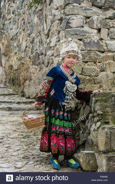 Long Skirt ethnic Miao  girl in traditional attire, Langde Shang Miao Village, Guizhou Province, China Stock Photo