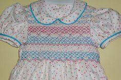 Chela Seijas.  Vestido # 4.  Piqué estampado bordado en los tonos de la tela.