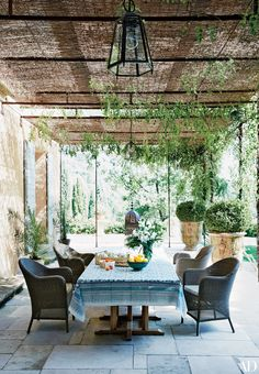 Balinese-teak tables from Designers Views anchor a terrace off the main house at…