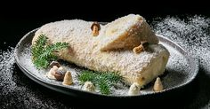 Learn how to make a bûche de noël with white chocolate ganache and coconut.