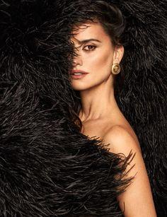 Ready for her closeup, Penelope Cruz poses in Saint Laurent dress and Versace earrings