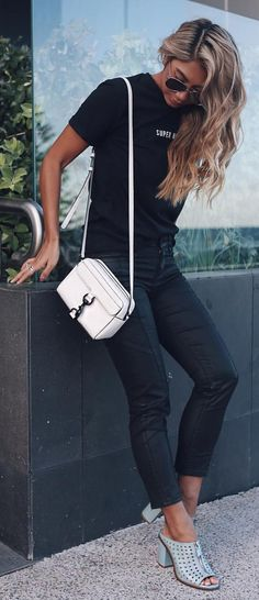 #spring #outfits  Black Printed Tee + Black Cropped Skinny Jeans + Grey Open Toe Mules + White Leather Shoulder Bag✨