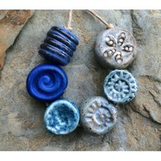 A set of handmade ceramic beads inspired by the northern winters I have experienced, both here and in my girlhood youth on the shores of Lake Superior.   The ceramic beads in this set were hand-formed out of stoneware, bisque fired once, glazed, then fired again to over 2200F in my ceramic kiln for a durable hard finish.