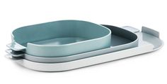 """Nabo Trays by Simon Legald for Normann Copenhagen. Stacking melamine trays with softly rounded raised edges with handles on each end, in small, medium, and large variations. """"Nabo"""" is the Danish word for neighbour, and Legald designed the set around this idea. """"I thought it was interesting how you could vary the few elements of an archetypal tray to retain similarity while the expression changes"""" Legald stated…"""