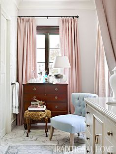 A powder blue slipper chair and leopard upholstered footstool provide glamorous places to perch and pamper in this bathroom. - Photo: Emily Jenkins Followill / Design: Matthew Quinn