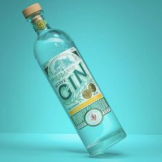 """Step Design created the beautiful graphic packaging for """"A Piece of Lovely Cake"""" which is a puff pastry product. The design features… Gin Bottles, Vodka Bottle, Steps Design, Bottle Design, Bold Colors, Biodegradable Products, Packaging Design, Alcohol, Graphic Design"""
